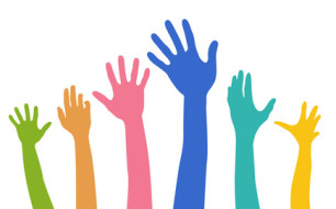 multicoloured hands raised as if voting. Illustration © Creative Stock -- Fotolia.com